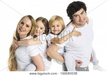 Parents giving children piggy back ride studio isolated on white background