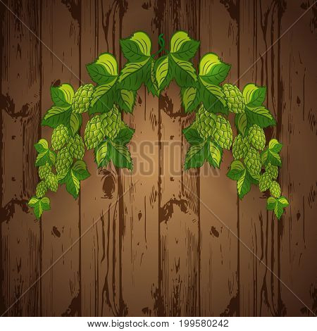 Garland: branches of hops with leaves and cones on a wooden background.Vector illustration.