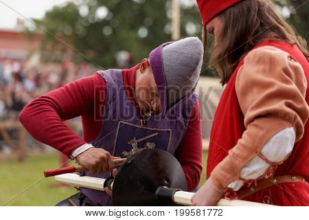 ST. PETERSBURG, RUSSIA - JULY 8, 2017: Participants preparing a lance for jousting tournament during the military history project Battle On Neva at St. Peter and Paul fortress. It's the 4th such event