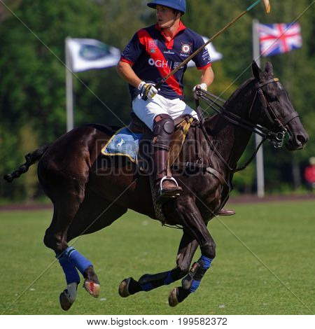 TSELEEVO, MOSCOW REGION, RUSSIA - JULY 26, 2014: Cameron Bacon of British schools in action in the match against Moscow Polo Club during the British Polo Day. Bacon become the best player of the match