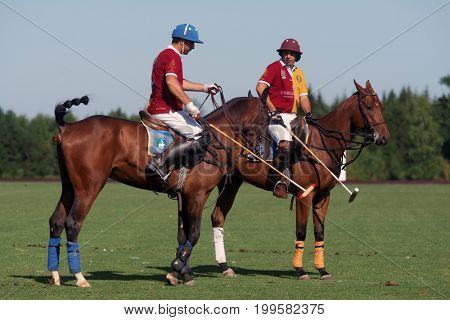 TSELEEVO, MOSCOW REGION, RUSSIA - JULY 26, 2014: Francisco Ramos (right) and unidentified teammate of Tseleevo Polo club during the break in the match against Oxbridge team during the British Polo Day