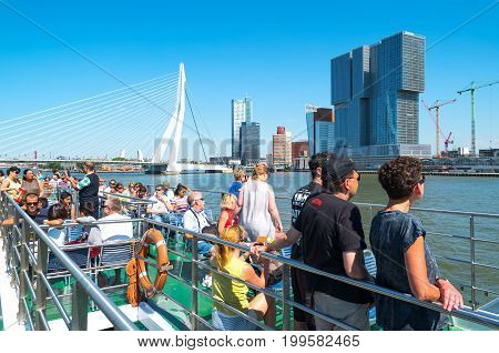 Rotterdam The Nederlands - July 18 2016: A boat with tourists crossing the Maas river