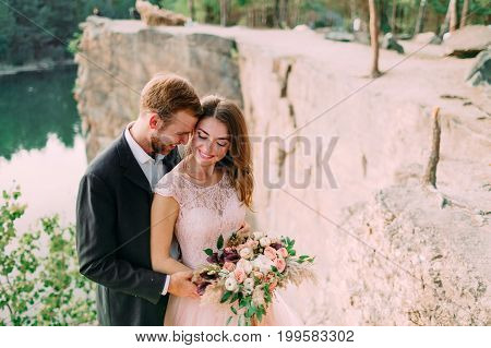 Attractive Couple Newlyweds Bride And Groom Laugh And Smile, Happy And Joyful Moment. Wedding Ceremo
