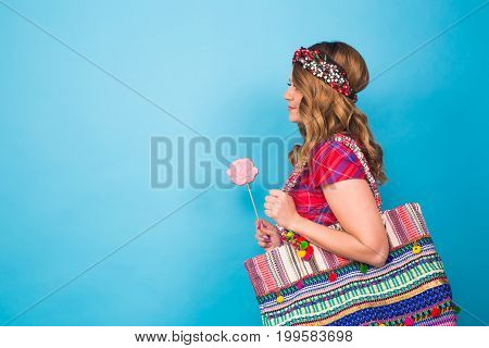 young woman with the colorful lollipop at studio.