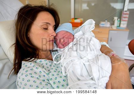 Happy Mom, Having Her Baby Skin To Skin First Seconds After Birth