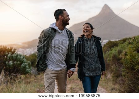 Young Couple Walking Together In Countryside