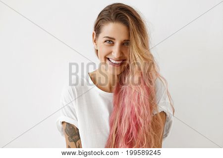 Pleasant-looking Cheerful Young Female With Blue Eyes, Long Luxuriant Hair, Tattooed Arms, Wearing O