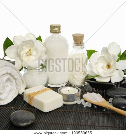 Set of with stones and gardenia ,soap ,salt in spoon,oil ,candle,on bamboo mat
