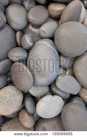 Natural seashore stones textured surface,