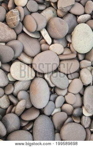 Texture of smooth gray stones, background