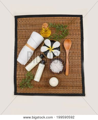 Spa treatment on mat with salt in bowl, oil