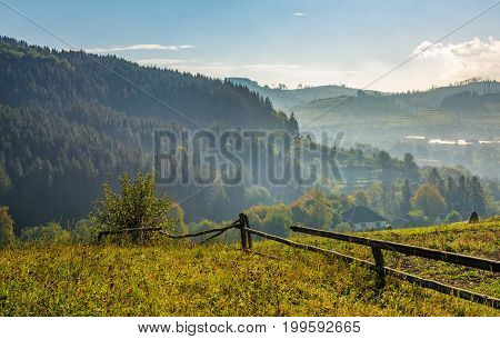 Fence Through Hillside With Rural Fields