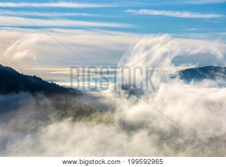 Thick Cloud Formation Rising From The Valley