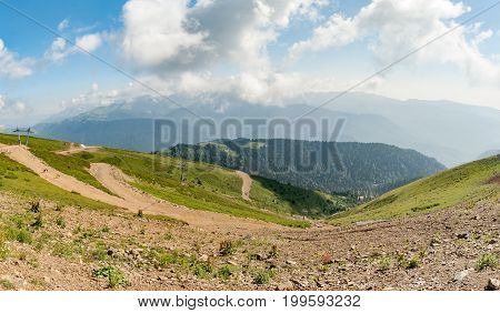 Panoramic View Of The Caucasus Mountains In Clear Summer Day