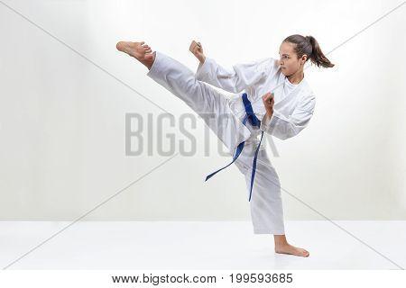 Kick leg sportswoman is beating in karategi