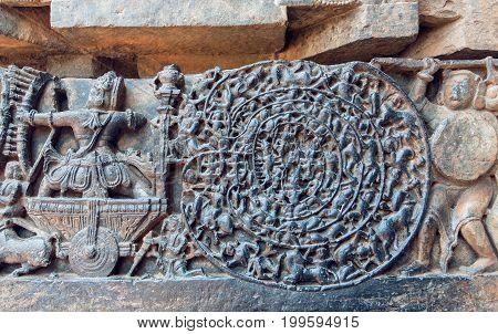 Hindu epic Mahabharata scene on carvings. Story of warrior Abhimanyu entering the Chakravyuha on stone artworks of the 12th century Hoysaleshwara temple in Halebidu, India.