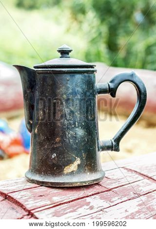 Style old metal coffee pot in retro