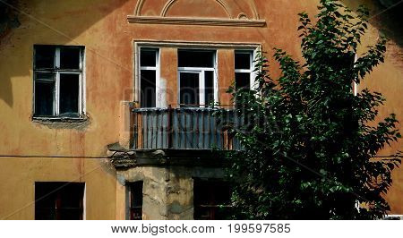 Fragment of old building. Old architecture. Old balcony. Old building. Balcony.