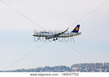 Stuttgart Germany - May 06 2017: Lufthansa Airlines Airbus A320-200 airplane during landing at airport Stuttgart