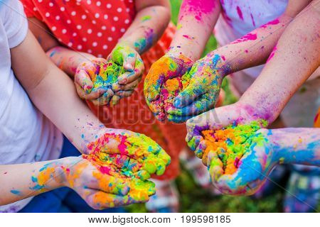 Paint holi on the hands of children