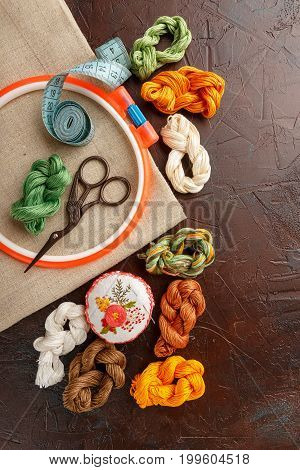 Set for embroidery embroidery hoop linen fabric thread scissors embroidered needle bed. Top view