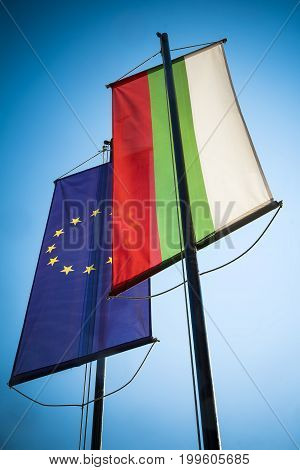 Bulgaria and European Union banners against blue sky