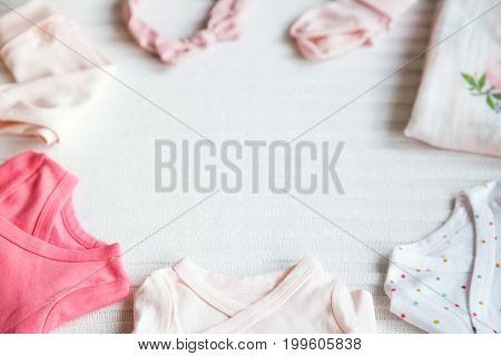 Baby Girl Clothes. Fabric Background.
