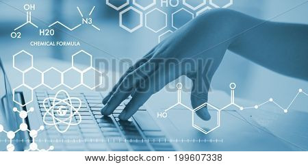 Graphic image of chemical formulas against schoolboy using laptop