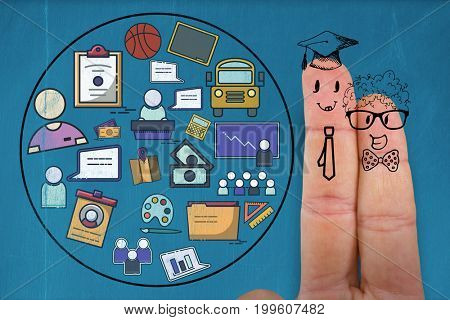 Graphic anthropomorphic smiley faces of male students on fingers against blackboard with copy space on wooden board