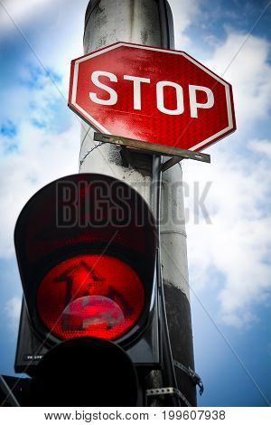 Red light stop sign at road junction