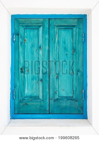 Green turquoise painted wooden window shutters. Green turquoise painted wooden window shutters. Architectural detail