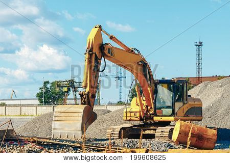 Tracked Excavator On A Construction Site Amid The Pile Of Rubble