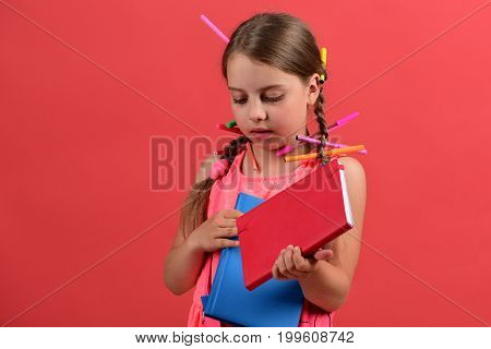Girl Holds Red And Blue Books. Back To School