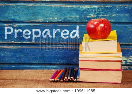 Prepared text on white background against apple with stacked books and pencils on table
