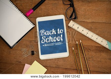 Back to school text over white background against overhead view of digital tablet with school supplies and eyeglasses