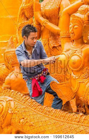 Ubonratchathani Thailand-April 30 2016: Artist man carving candle for marching in candle festival in Ubonratchathani Thailand