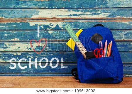 I love school text on white background against school bag on table