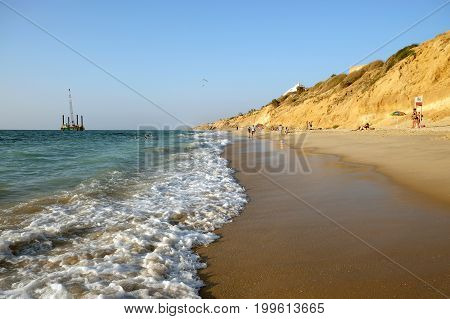 City beach in Ashkelon and offshore drilling platform in the Mediterranean Sea