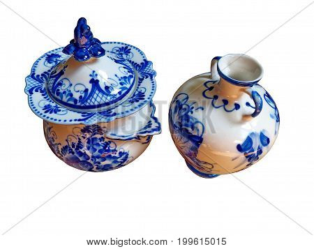 Sugar bowl and a vase on a white background. Things in Russian traditional Gzhel style. Gzhel - Russian folk craft of ceramics and production porcelain and a kind of Russian folk painting.