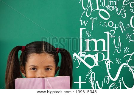 letter and number jumble against schoolgirl hiding behind a book against green background