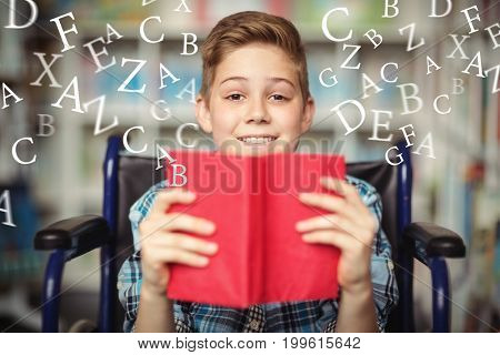 letters against portrait of disabled schoolboy holding book in library