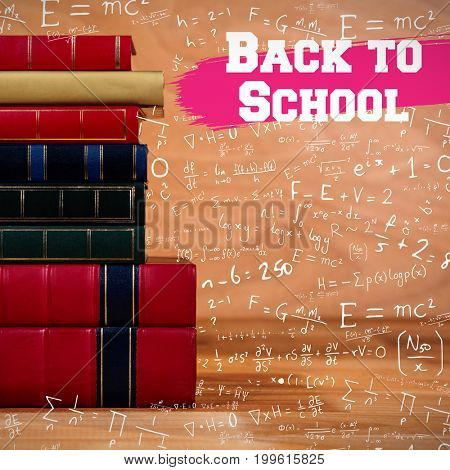 Back to school message against books stack on table