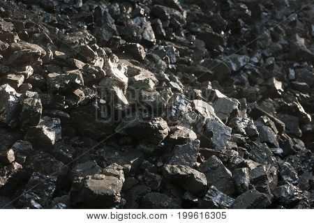 Natural black coals.for background. Industrial coals. Pile of coal for sales