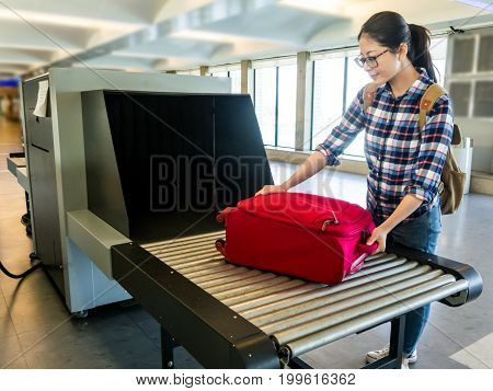 Put Luggage At Point Of Checking The Scanner