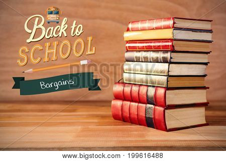 back to school against stack of hardcover books on table
