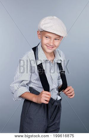 Old Fashioned Boy And Looking Sideways On Gray Background
