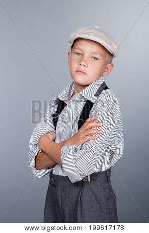 Old Fashioned Boy And Looking To The Camera On Gray Background