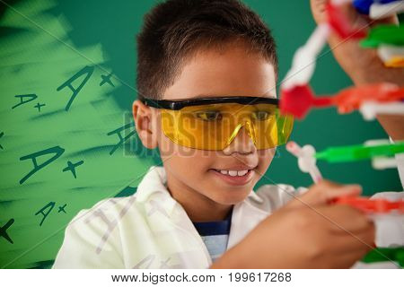 A plus grade on black scribbling against schoolboy experimenting molecule model in laboratory