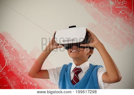 Digital image of equations against schoolboy using virtual reality headset