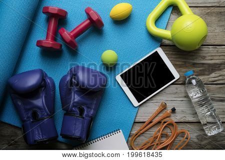 Time for exercising sport equipment with yoga mat background
